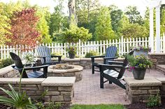 Brick patio, stone wall, firepit with Adirondack chairs {Farmhouse Revival}