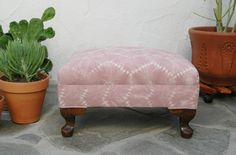 Upholstered ottoman with rose quartz fabric. We created a custom surface pattern using the nui shibori technique (stitch-resist shibori) especially for this vintage spring ottoman. Inspired by Hmong batiks, Navajo rugs and African mudcloth patterns, the tribal design was hand-stitched onto natural cotton canvas and then hand-dyed. The result is a beautiful rose quartz or pink, with an organic, geometric pattern. The upcycled wood frame has curved cabriole legs.