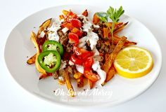 These Loaded Sweet Potato Fries with Creamy Cajun Ranch are low in fat but LOADED with flavor & nutrition! THM friendly, gluten/egg/nut free, real food.