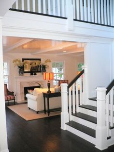 Dark wood floors, white trim