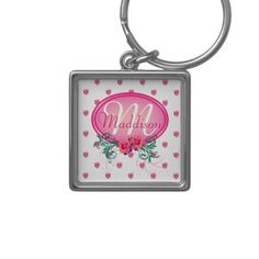 http://www.zazzle.com/pink_frame_monogram_rose_key_chain-146146757029837515?rf=238523064604734277 Pink Frame Monogram Rose Key Chain - This key ring has lots of pink roses all over. It has a pink monogram frame with roses and green foliage in which to place your name and initial. This would make a wonderful first car gift for your daughter, or a nice, personal Christmas or birthday gift for your wife or mother.