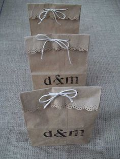 Brown paper lunch sacks to hold wedding favors.  Very charming. #wedding #weddingfavors #DIYwedding #weddingdecor