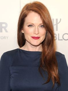 Julianne Moore At the amFAR New York Gala.  The New Red Hues From the red carpets to the runways, crimson shades are taking over. See how here.the A-list is rocking the new rosy strands.