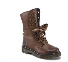 The perennially popular silhouette of the historically important biker boot remains an appealing shape for Dr. Martens to experiment with. The low height Aimilie Toe Cap Boot offers a versatility of look: worn up they are strikingly Dr. Dark Brown, Combat Boots, Cap, Silhouette, Shoes, Black, Women, Fashion, Baseball Cap