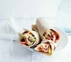 Easy, healthy wraps have carrots and Napa cabbage for crunch, pineapple for sweetness, and a sour cream–based dressing for creaminess.