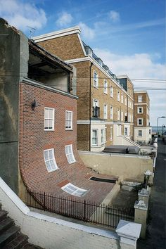 From the Knees of My Nose to the Belly of My Toes is a surreal display by British designer Alex Chinneck that makes it look like the brick facade is sliding right off the front of a building in Margate, England Unusual Buildings, Abandoned Buildings, Architecture Unique, Interior Architecture, Interior Design, Brick Architecture, Room Interior, Crazy Houses, Brick Facade