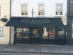 Murrays of Eton with their recovered Victorian Shop Blind by Deans Blinds And Awnings