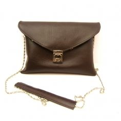 The perfect going out clutch with credit card pockets, long pocket for paper money, detachable bag chain, zip + phone pocket.