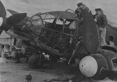 RAF officers examine the wreck of a Heinkel He 111 on an airfield in Libya. Photo was taken on 11 January US National Archives Fighter Aircraft, Fighter Jets, Navy Carriers, Ah 64 Apache, Command And Control, National Archives, Fun Shots, United States Navy, Luftwaffe