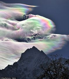 "Pinner writes: ""Oleg Bartunov caught the spectacle on camera during a Himalayas expedition in Nepal. An Iridescent (Rainbow) Cloud in Himalaya. The phenomenon was observed early morning on October 18, 2009 on the path to Khumjung in the Himalayas."""