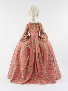 French Dress (Robe à la Française), ca. 1775. Pink ribbed silk with white linear silk vine motif and multicolored silk floral brocade with passementerie and scalloped fly fringe trim. Isabel Shults Fund, 2005 (2005.61a, b).