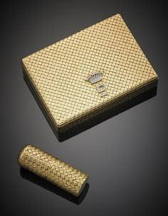 VAN CLEEF & ARPELS A basket weave compact and lipstick holder, diamond-set on white gold initials and crown.
