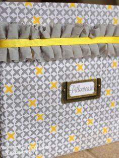 Turn an old diaper box into a storage bin with some patterned sheets and ribbon.