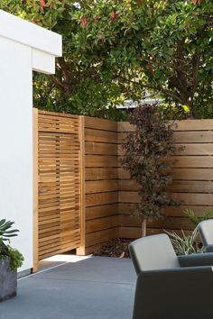 Contemporary horizontal wood fence and gate by gabrielle
