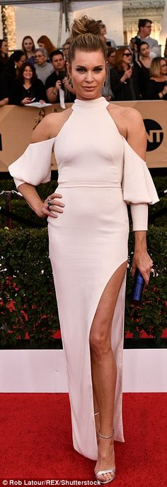 Bit of all white: Missi Pyle, Rebecca Romijn and Julie Bowen stunned in pale shades...