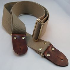 Leather and Canvas Guitar Strap 50mm  Handmade in the UK Guitar strap that sits comfortably on your shoulder. The ends are cut veg tan leather, with bees wax buffed edges, The leather has been treated with a finishing cream that contains wax compounds that makes it supple and gives the leather a natural shine. Once gain the strap is fully adjustable to suit both height and guitar of the player. As a guitar player a solid comfortable strap is a must have item.  Please check the box for the…