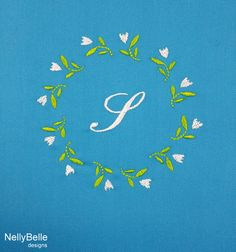 A tiny tulip monogram embroidered on turquoise linens. NellyBelle Designs.