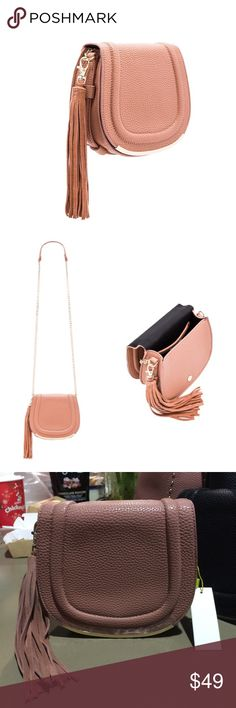 BCBGeneration Tassel Saddle Bag in Blush Brand new. Let me know if you have any question. BCBGeneration Bags Crossbody Bags