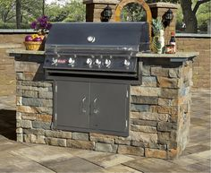 An outdoor grill from Cambridge Pavingstones with Armortec is a great way to enjoy your backyard all year round.