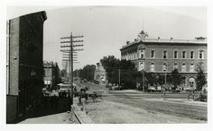 An 1890s era photograph on the corner of 24th Street and Washington Boulevard. ON the right is the ZCMI Building constructed in 1881 which later became the W. H. Wright store and the J.C. Penney store before it was torn down to build the Ogden City Mall. The transportation modes of the time are seen in the horses and buggies and the horse drawn trolley. Utah State Historical Society photo.