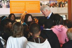 THINKING ABOUT TOMORROW: Clinton with some of the thousands of Arkansas schoolchildren who visit the Clinton Center around the year image