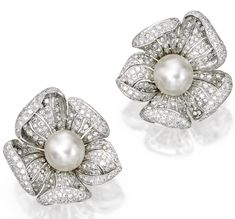 Pair of 18 karat white gold, cultured pearl and diamond earclips - The flowerheads centered by two cultured pearls measuring approximately mm, the petals set with numerous round diamonds weighing approximately carats. High Jewelry, Pearl Jewelry, Diamond Jewelry, Silver Jewelry, Bow Jewelry, Jewellery, Silver Ring, Pearl Necklace Designs, Anniversary Jewelry