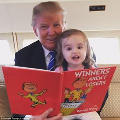 Great story, grandpa: Donald Trump is seen reading Winners Aren't Losers to his granddaughter Chloe Sophia, seemingly on a private jet, in a photo posted to Twitter on Friday. The book was made by Jimmy Kimmel