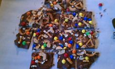 Trail Mix Bark- melt chocolate chips, spread on parchment paper, sprinkle m, cashews, and pretzel pieces on top, let cool for 2 hours, cut, and enjoy!