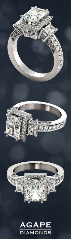 This three stone radiant cut engagement ring is positively divine. The intricate details in the pavé halo and astonishing see-through filigree below the crown, radiates a look that is contemporary yet heirloom while the beaded crescents and milgrain borders along the cathedral setting, make this ring an absolute stunner.  This Radiant Cut Engagement Ring comes as pictured with a 2.0Ct Radiant Cut simulated diamond and 1.12Ct in side stones. (Total Carat Weight: 3.12 CTW).