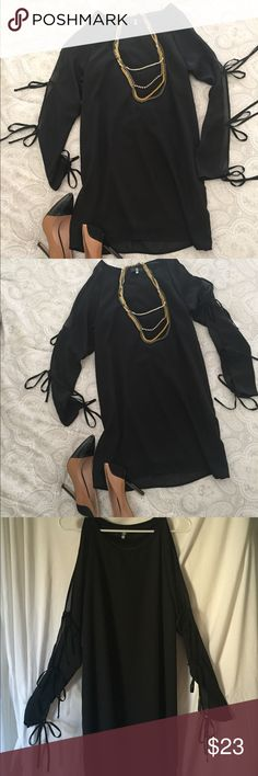🖤NWOT BLACK DRESS🖤 🔥SEXY LITTLE BLACK DRESS! Cold shoulder and exposed arms w/ties up the arm. NEVER WORN! this black beauty will be your new go to piece for the weekend!!! Size 8 Dresses