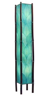 A simple and stunning lamp with real Cocoa leaves and sturdy bamboo legs. Fossilized cocoa leaves are handplaced and laminated on to a standard UL lamp backing, creating each of the four sides of the lamp. The panels are handstitched onto a powder coated, wrought iron frame to form a square design. Shown here in blue