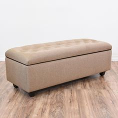 This contemporary storage bench is upholstered in a durable woven light tan fabric. This ottoman is in great condition with a tufted lift up top, large interior cabinet space and dark wood block feet. Comfortable seat perfect for storing linens at the end of a bed! #contemporary #storage #storageottoman #sandiegovintage #vintagefurniture