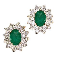 7x5mm. Oval Emeralds surrounded by 1 carat of round brilliant cut diamonds in 14-karat gold.  Sale Priced at $1,800.