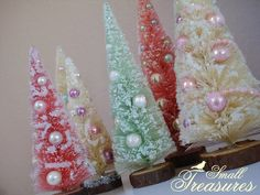 bottle brush trees - buy a pack of green trees at a hobby store, soak them in bleach 'till they turn white, dye them with fabric dye, spray glue, sprinkles, faux snow, beads, paint the bases or cover with faux snow...DONE.  My next project....