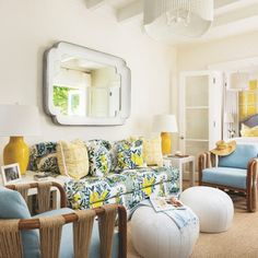 "The guest bedroom's sitting area, dubbed ""the cabana room,"" is anchored by a sofa adorned with the aptly named Citrus Garden fabric by Schumacher. The poufs are by Made Goods and the linen-upholstered Palecek string chairs are from Hive."