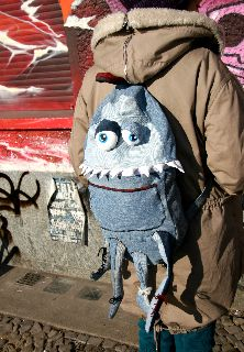 """Here I make from second hand clothes, old sheet metal, paper, wood, … objects of utility. At the moment I use old jeans very often: with a lot of patience hole filled trousers become little monsters: backpacks, bumbags, hot water bottles and other things people need. You can find other rag-monsters here."""""""