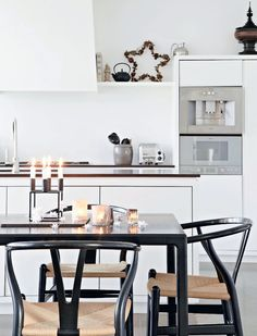 Kubus 4 candle holder by Mogens Lassen from by Lassen and Wishbone chair by Hans J. Wegner from Carl Hansen & Søn
