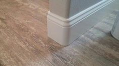 """6 1/4"""" Baseboard installed with rounded bullnose corners. Love the wall color with the trim color."""