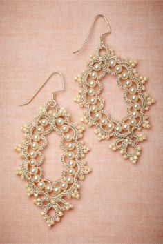 "Prato Earrings from BHLDN: Exquisite, intricate, and vintage-inspired. L'Orina's signature tatting technique transforms glass pearls into radiant, wearable art. Sterling silver fishhook closure. 2.5""L, 1.5""W. Glass pearls, glass beads, cotton and polyester thread. France."