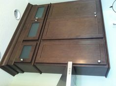 We LOVE this stacked cabinet look with frosted glass inserts!  So sleek! [Copper River Cabinet Company]