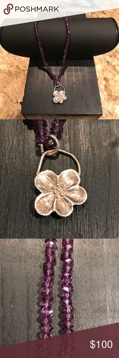 Beautiful amethyst sterling silver necklace These amethysts are all hand carved by a man in Martha's Vineyard. They are absolutely stunning and catch the light in every direction. The flower pendant is a sterling silver delicate flower. It goes beautiful with the color of these magnificent hand made stones. This necklace measures 18 inches from clasp to flower. Thank you. hand made Jewelry Necklaces