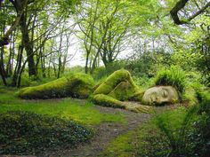 moss covered garden statue