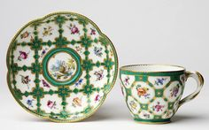 a sevres porcelain tea set - the cups having handles, which was the latest thing in the 1760s.
