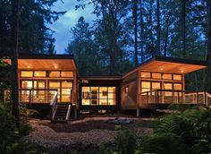 Method Homes installed this modern modular home, referred to as m2, on a picturesque mountain site in Glacier, Washington with a ductless mini split system, a wood stove, foam and cellulose insulation, and metal siding and roof.