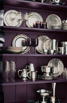 Antique silver serving pieces and deep jewel tone wine goblets set cupboard painted in  Ralph Lauren Paint's Embassy Purple.