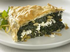 Crisp pastry encases a delicious blend of spinach, feta, and pine nuts in this classic Middle Eastern dish. Good with a crisp salad or a selection of seasonal vegetables.