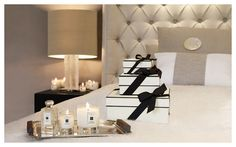 divine perfumed candles and glamorous bedding - fabulous deep buttoned headboard and lighting!
