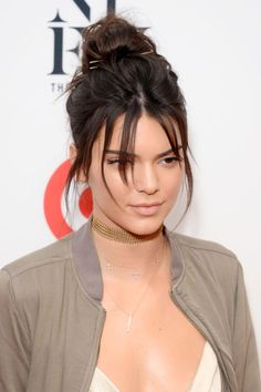 Kendall Jenner brings us back to our youth with this bun paired with piecey bangs look. Check out her complete hair evolution!