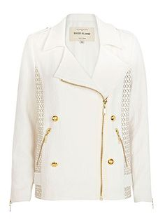 Take a classic like the biker jacket and this season's hottest white hue and what do you get? This double-breasted jacket with cut-out details and gold zips