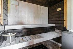 Sauna with a modern black and white color palette